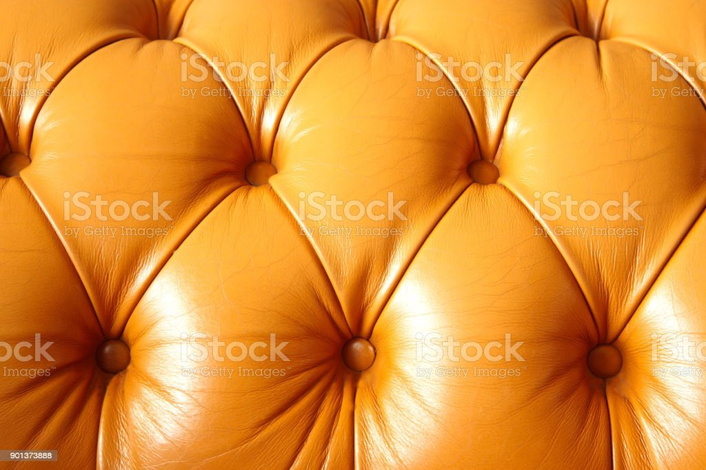 brown leather of luxury sofa decoration texture background stock photo