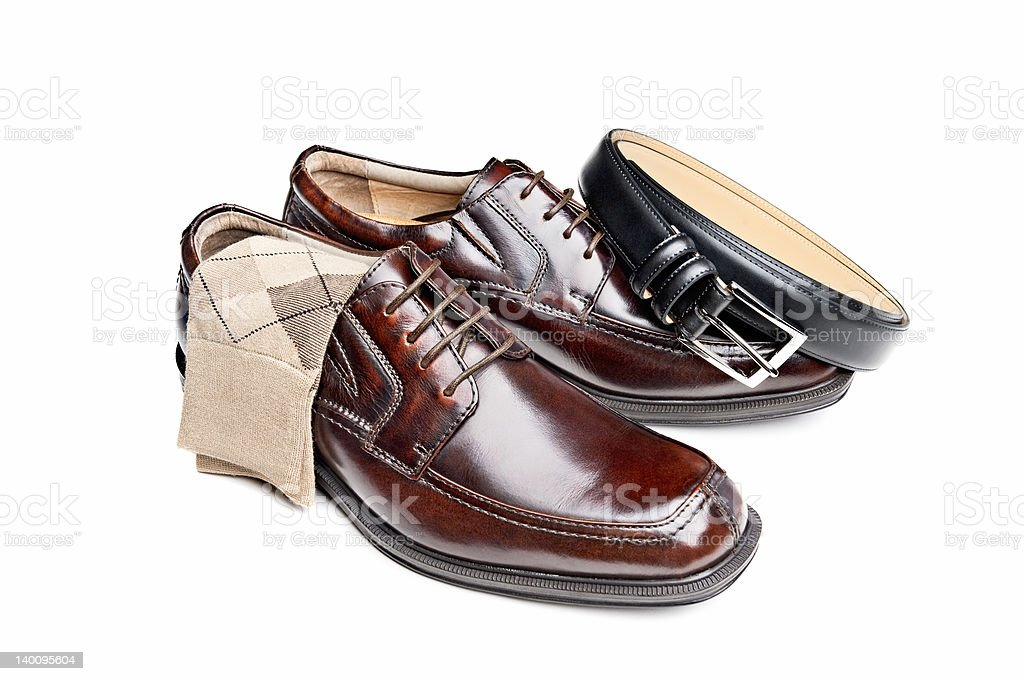 Brown leather shoes with socks and belt stock photo