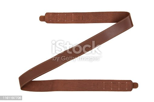 Brown leather shoulder strap for a gun isolated on white background