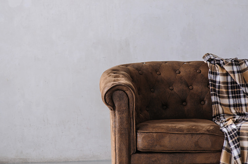 brown leather sofa on light background