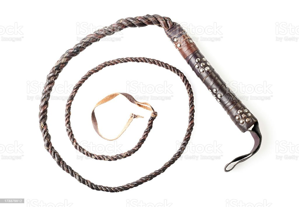 Brown leather whip forming a spiral on a white background stock photo