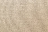 Brown linen fabric cloth texture background, seamless pattern of natural textile.