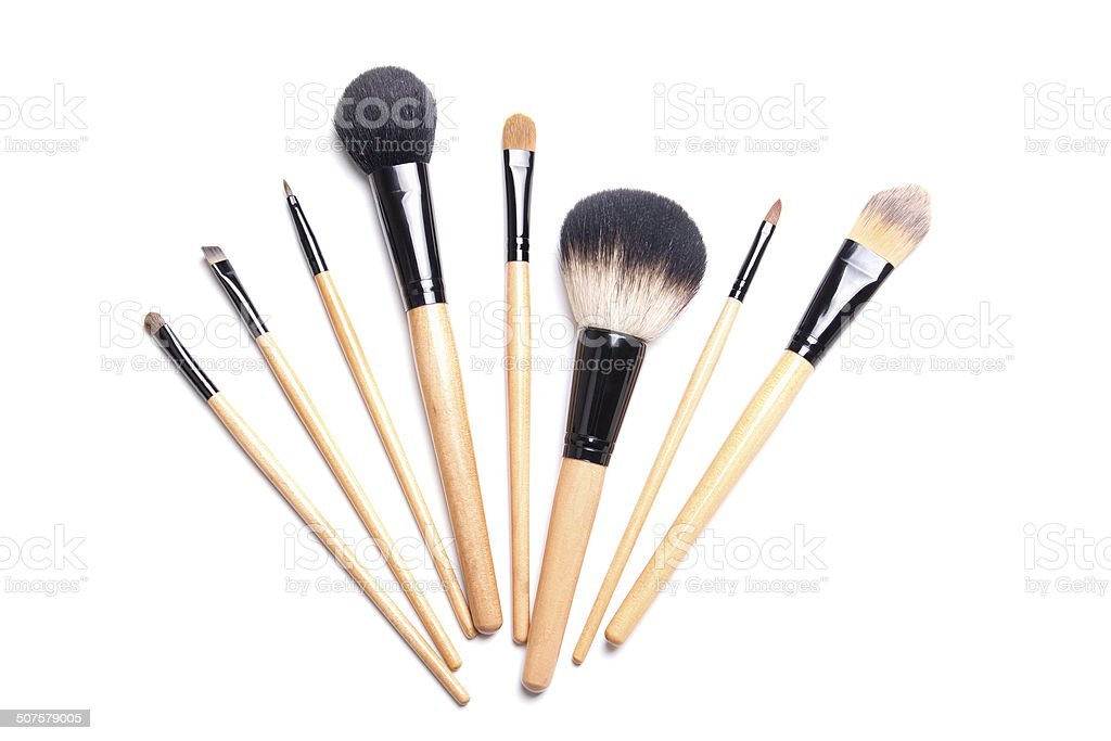 brown make-up brushes isolated on white stock photo