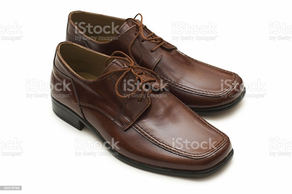 Brown male shoes isolated on the white royalty-free stock photo