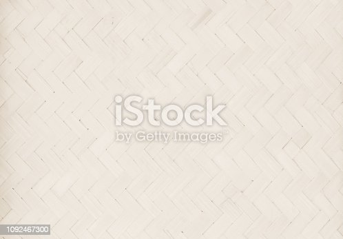 Brown Mat Traditional handicraft bamboo weave texture background. Wicker surface pattern material for wall with antique cracking furniture painted weathered white vintage peeling wallpaper or board.