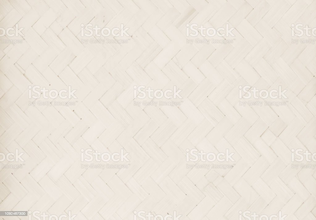 Brown Mat Traditional handicraft bamboo weave texture background. Wicker surface pattern material for wall with antique cracking furniture painted weathered white vintage peeling wallpaper or board. stock photo