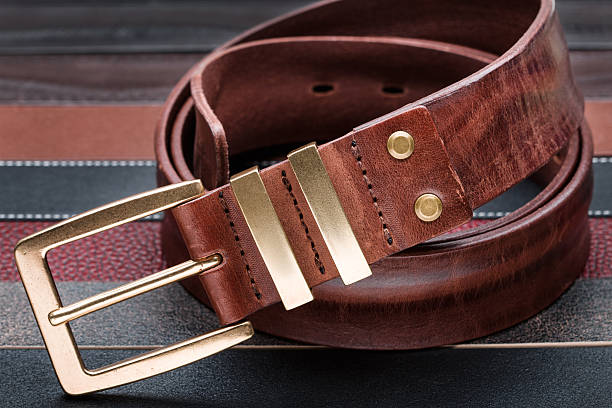 Brown men leather belt with golden buckle stock photo