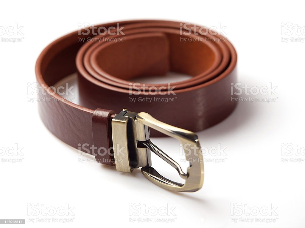 Brown men's belt with bronze clasp over white background stock photo