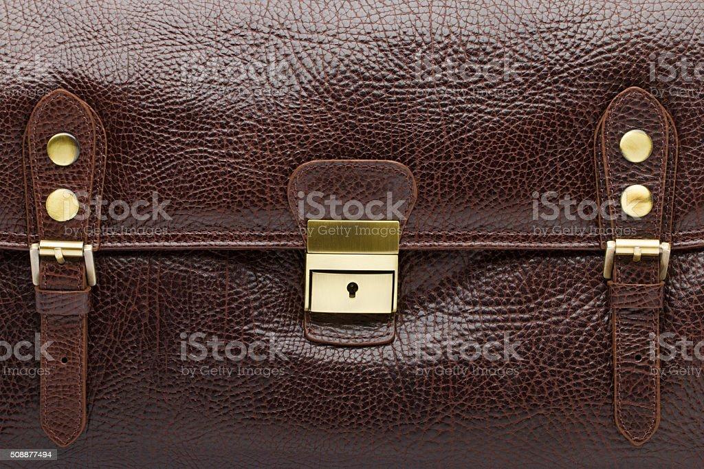 Brown natural leather men bag closeup stock photo