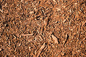 Brown, natural mulch texture with a warm atmosphere