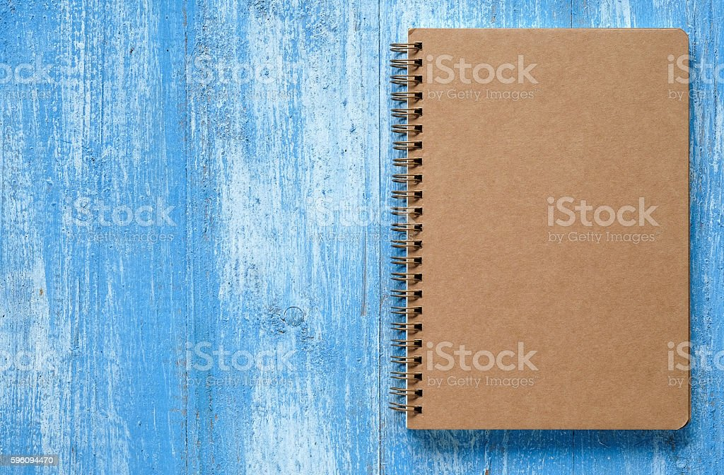 Brown notebook on blue wooden floor. royalty-free stock photo