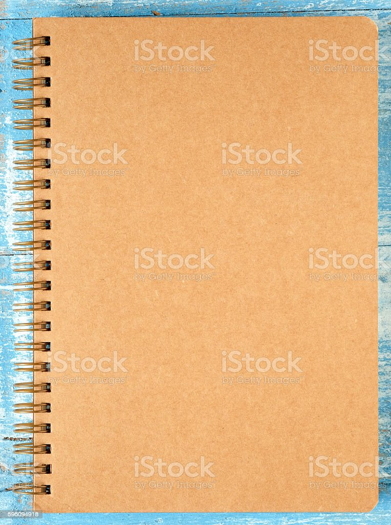 Brown notebook on blue wooden floor. Lizenzfreies stock-foto