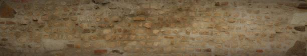 Braune alte Ziegelwand in 16: 9 in ultrabreitem Format. – Foto