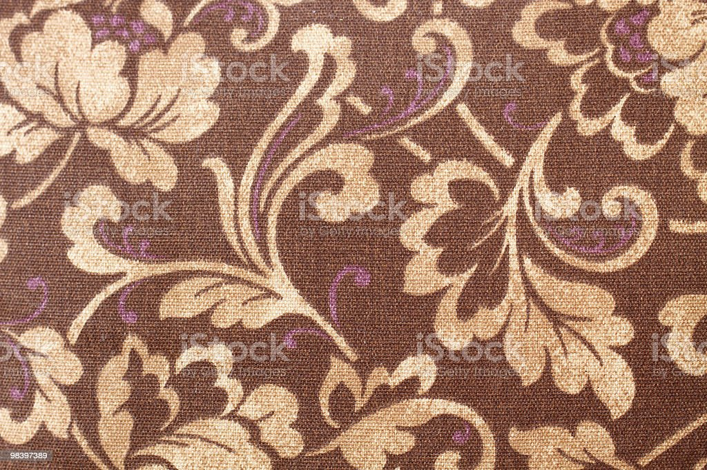 Brown, orange and yellow paisley fabric royalty-free stock photo