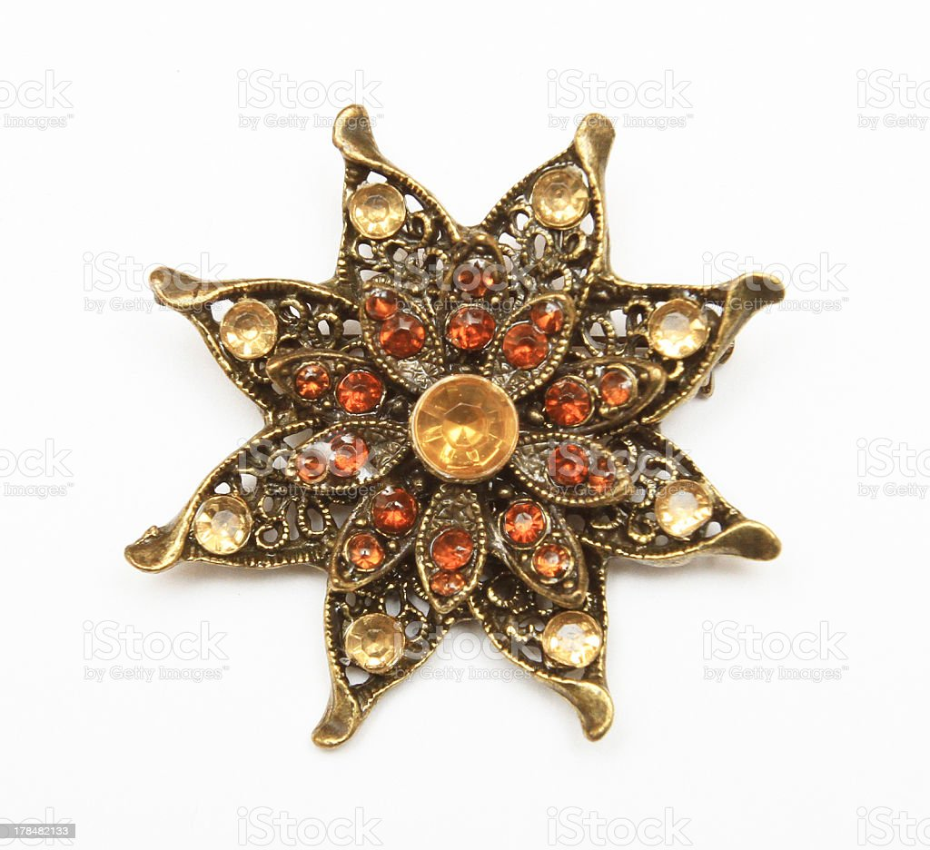 Brown Orange Gold Rhinestone Vintage Pin Brooch on White Background stock photo