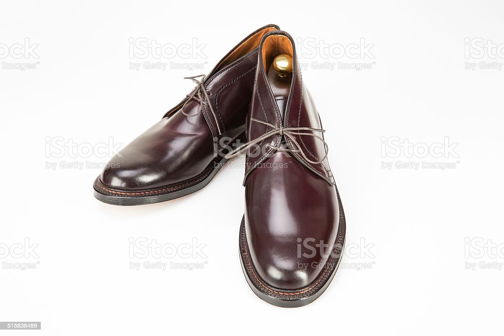 Brown Oxford business shoes on white stock photo