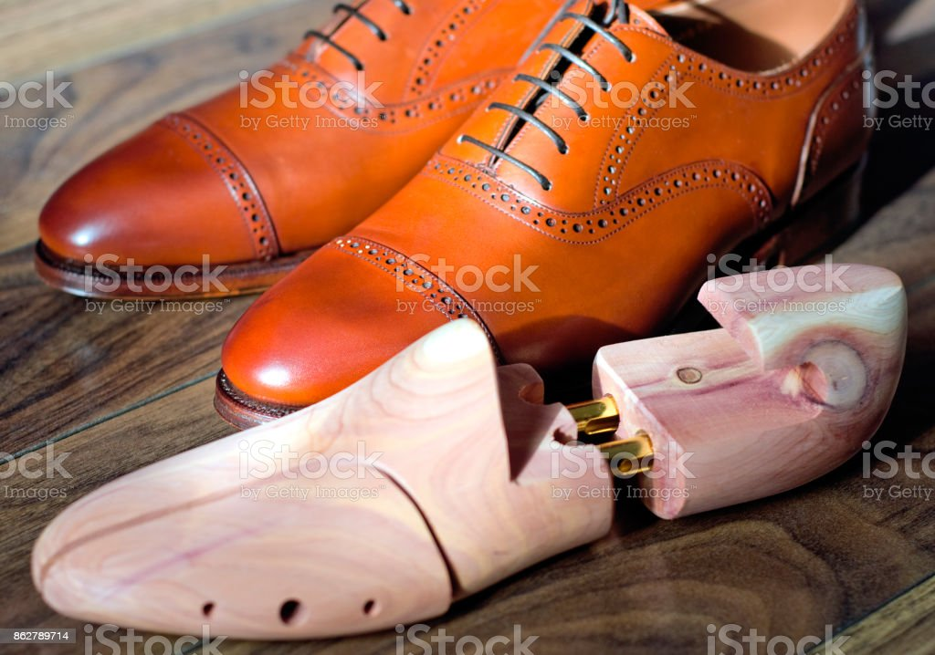 Brown oxfords and shoetree stock photo