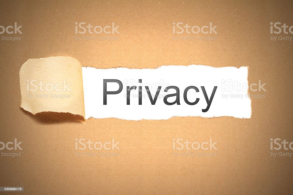 brown packaging paper torn to reveal privacy stock photo