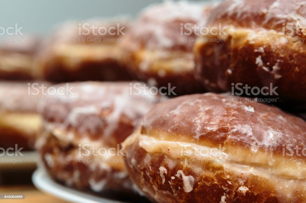 Brown 'Paczki' Donuts on White Plate.