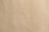 istock Brown paper, a little bit crumpled, cardboard texture. 486259236
