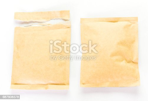 912671588istockphoto brown paper and torn paper food package on white 687908378