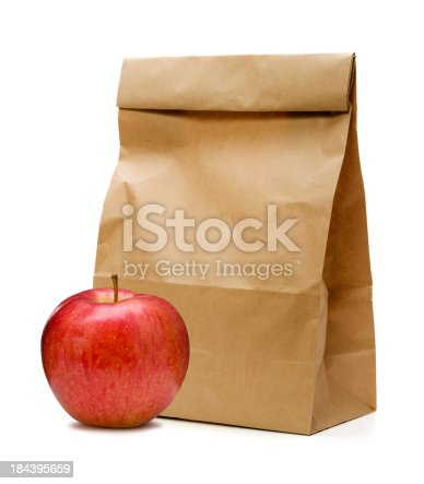 Brown Paper Bag and apple on white