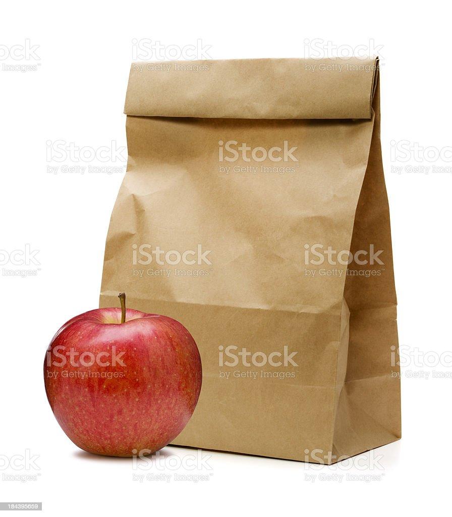 Braune Papiertüte und apple – Foto