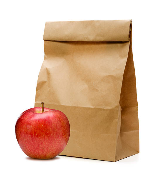 brown paper bag and apple - lunchlåda bildbanksfoton och bilder