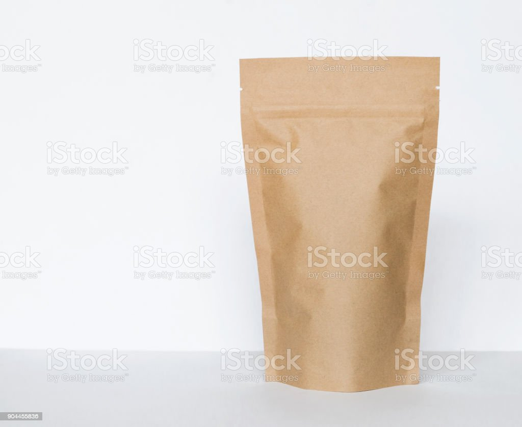 Brown paper bag on white background – zdjęcie