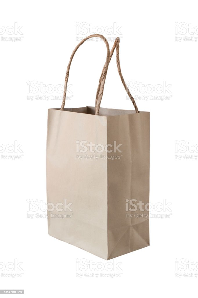 Brown paper bag on white background royalty-free stock photo