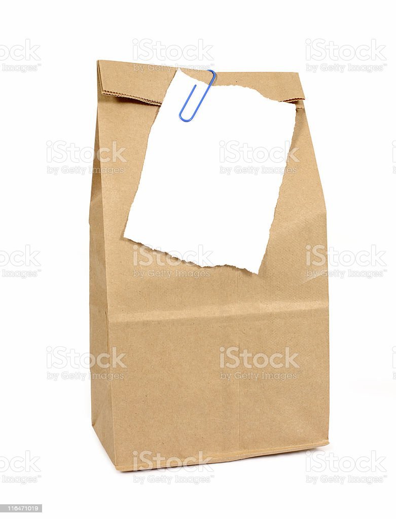 Brown paper bag with notepaper royalty-free stock photo