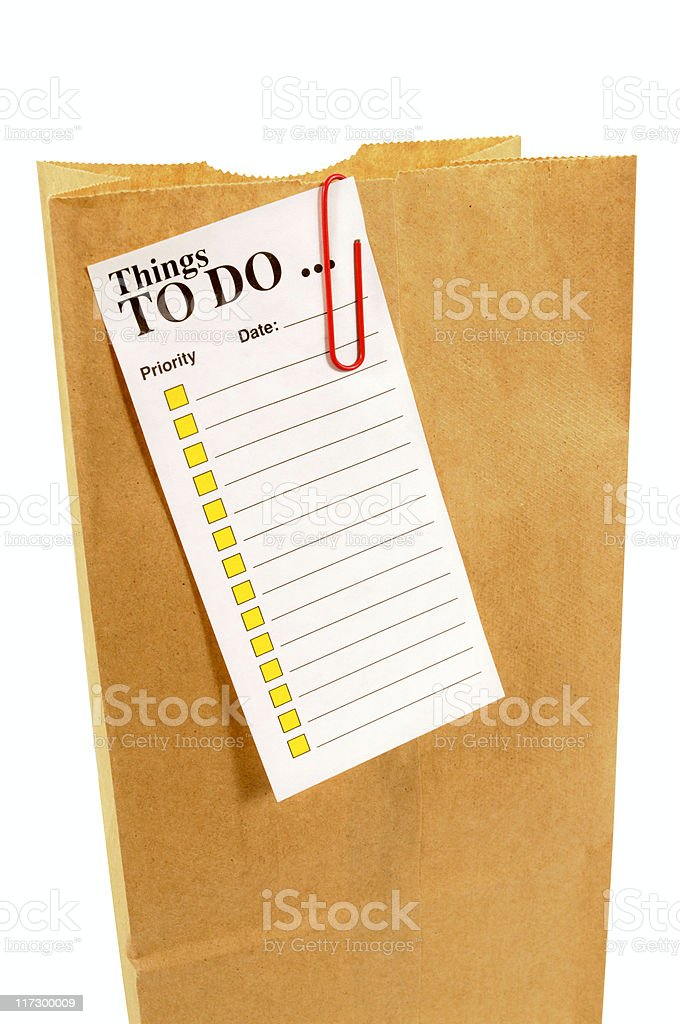 Brown paper bag with task list (XL) royalty-free stock photo