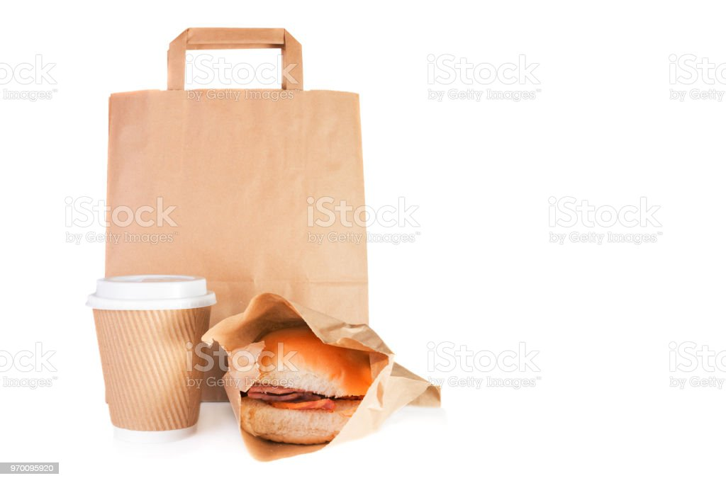 Brown paper carrier bag, take away paper cup, bacon roll in a take away wrap stock photo