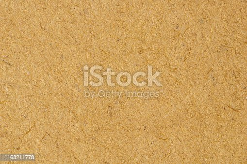947207308istockphoto Brown paper close up texture background 1168211778
