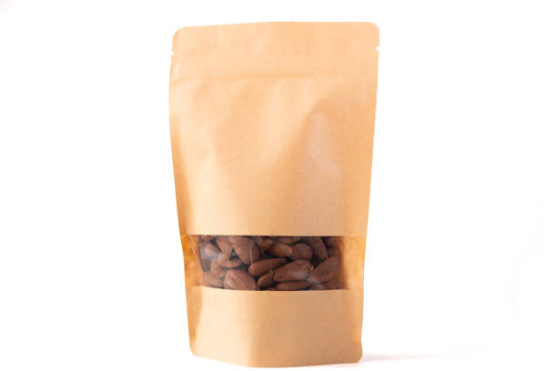 brown paper doypack stand up food pouch filled with almond with window zipper on white background stock photo
