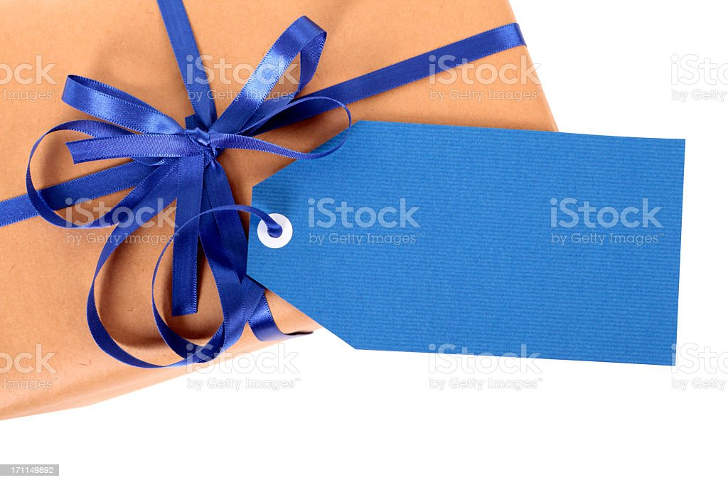 Brown paper gift with blue ribbon and gift tag royalty-free stock photo