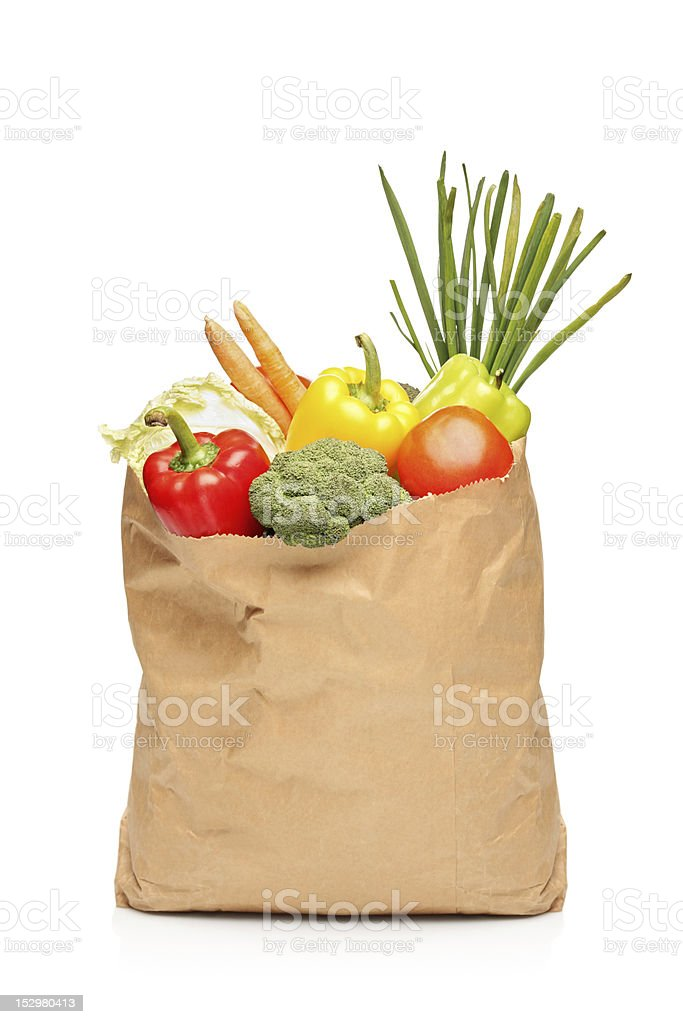 Brown paper grocery bag full with fresh vegetables stock photo