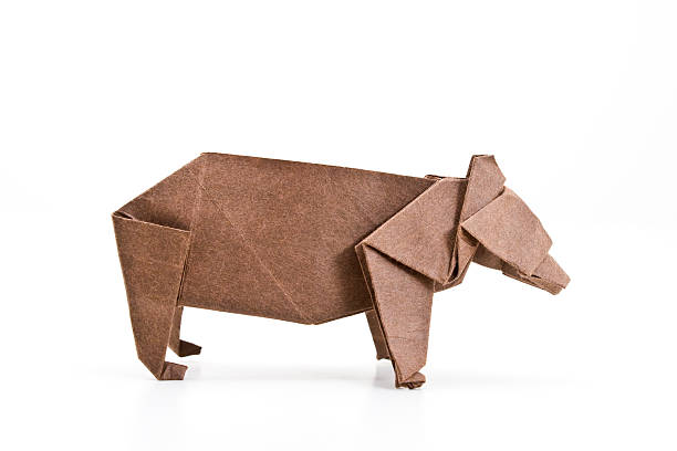 A brown paper origami bear on a white background stock photo