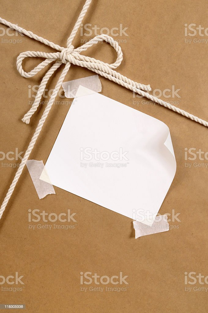 Background of brown paper package with curled corner label. To see my...