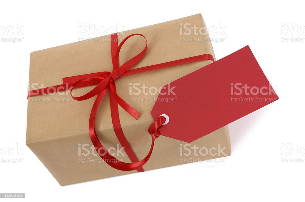 Brown paper package with red ribbon and tag royalty-free stock photo