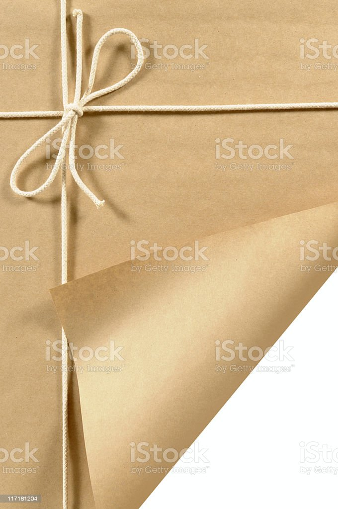 Brown paper parcel with curled corner stock photo