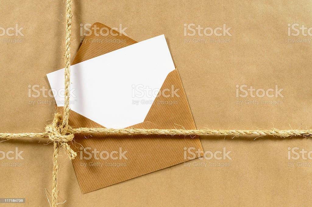 Brown paper parcel with envelope royalty-free stock photo