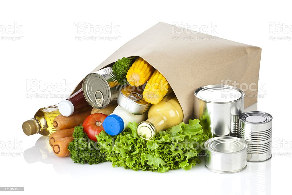 Brown paper shopping bag laying on white backdrop royalty-free stock photo