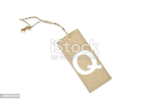 istock Brown paper tag with letter Q cut 483342606