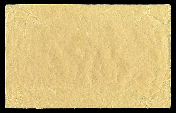 Brown Paper textured isolated on black background stock photo