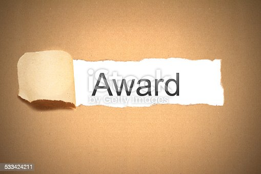 istock brown paper torn to reveal award 533424211