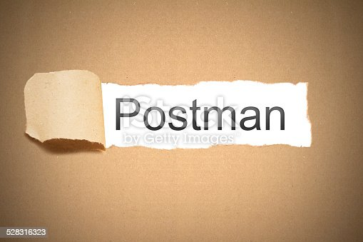 istock brown paper torn to reveal postman 528316323