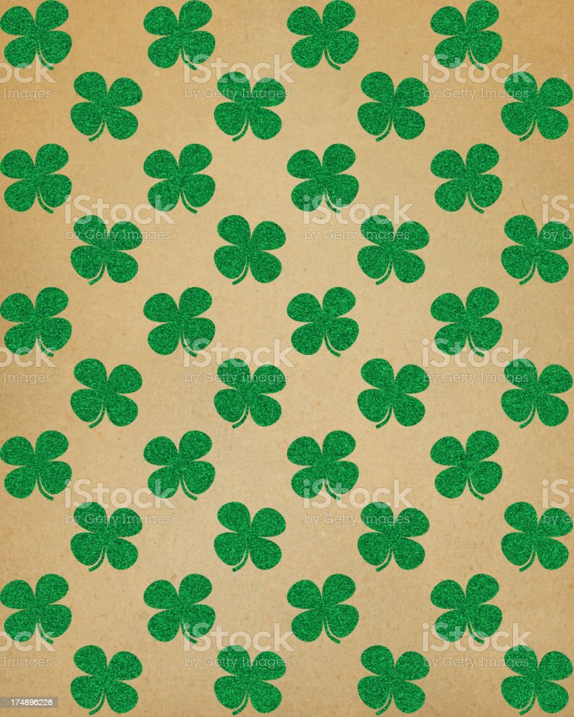 brown paper with glitter clover pattern royalty-free stock photo
