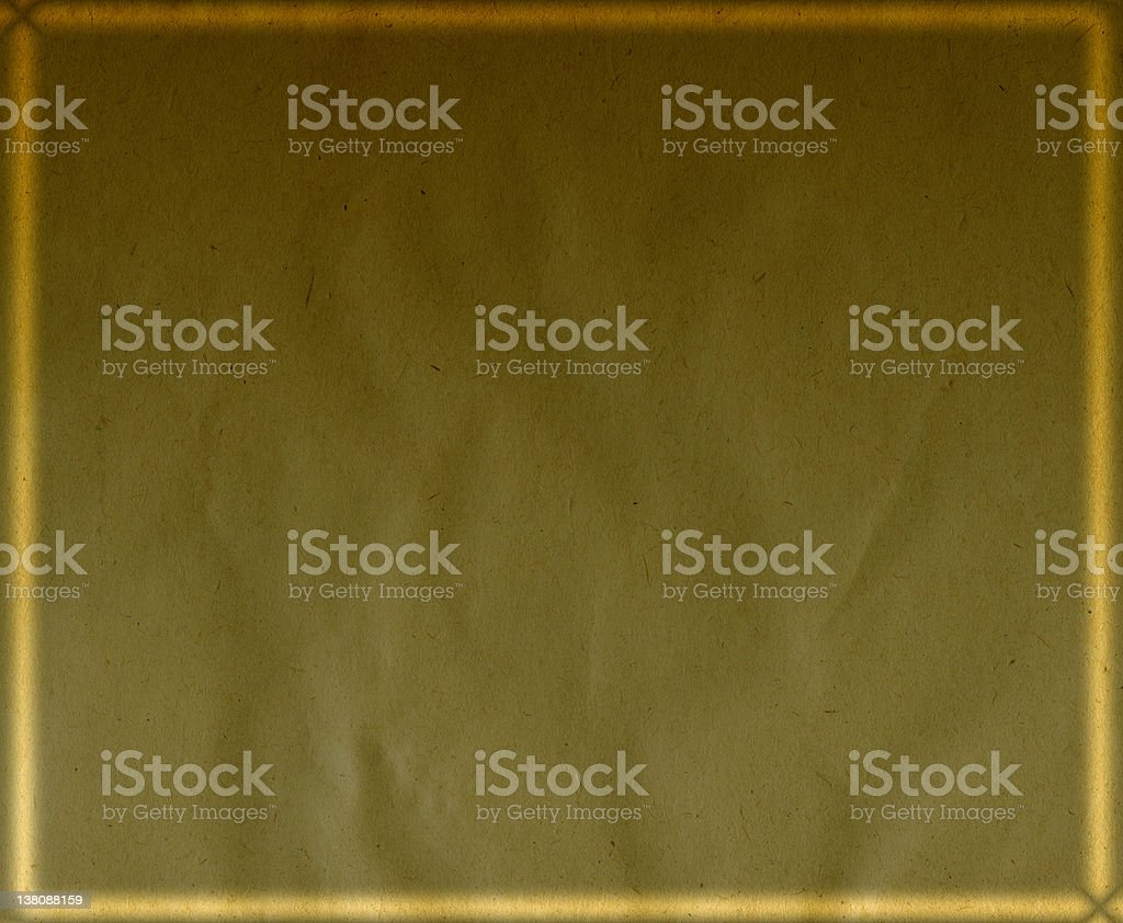 Brown paper with gold frame in the background royalty-free stock photo