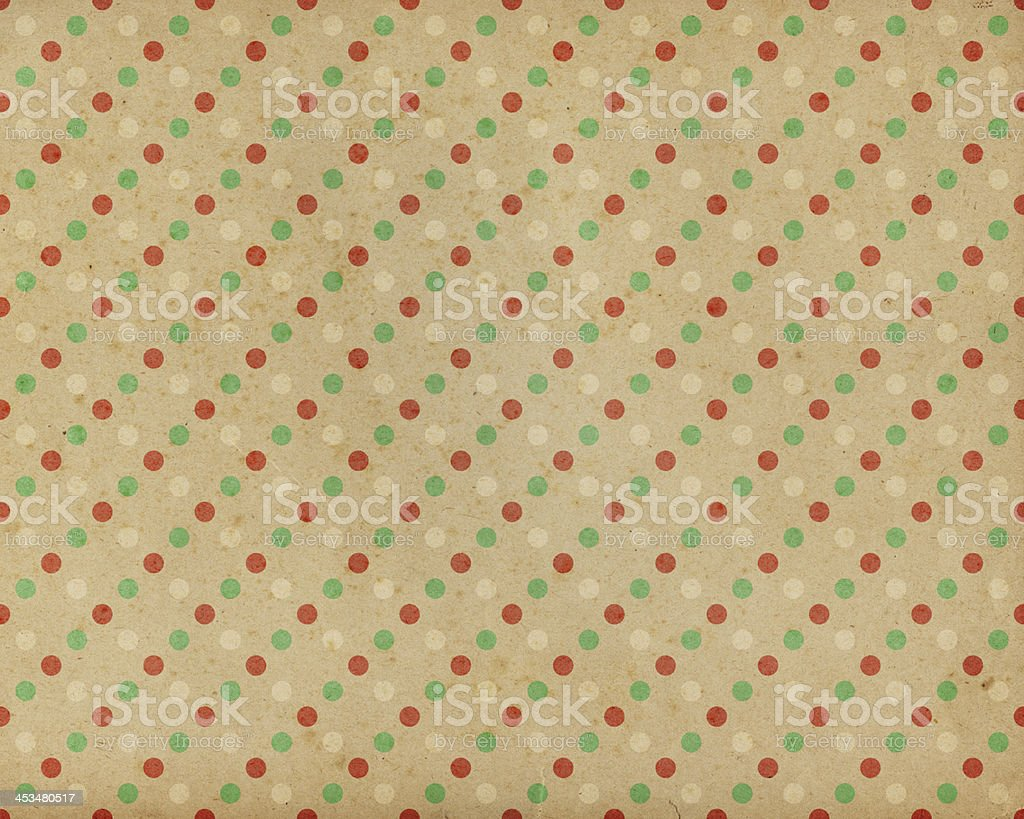 brown paper with red and green dots stock photo